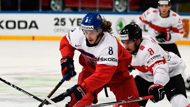 Czech Republic's defender Libor Sulak, center, vies with Switzerland's forward Vincent Praplan, right, during a IIHF Men's World Championship game May 16, 2017 in Paris.
