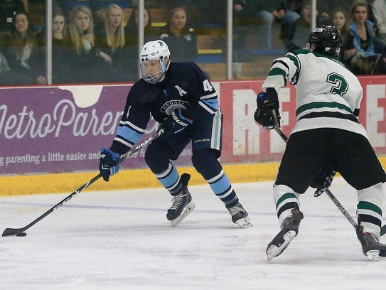 Stevenson defenseman Jake Beaune (left) tries to move