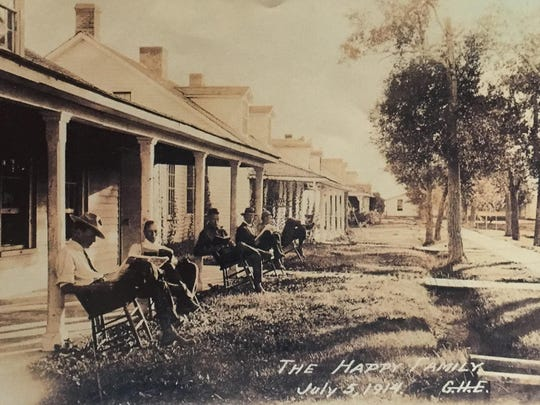 "Labeled ""the happy family,"" this 1914 photo shows original officer quarters. The Sun River Historical Society is repairing one of the remaining buildings."