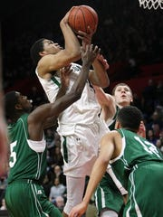 St. Joseph's Karl Towns loses his handle on the ball while going to the hoop between East Brunswick's Amir Bell (left) and Alex Fitzgerald on Feb. 27, 2013, at the Louis Brown Athletic Center in Piscataway.