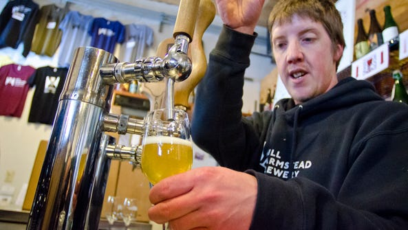 Phil Young pours beer at the Hill Farmstead Brewery