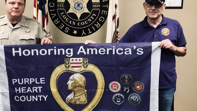 Logan County is celebrating National Purple Heart Day on Friday to honor the organization. Sheriff Mark Landers and Joe Schaler proudly display the Military Order of the Purple Heart flag that fly's below Old Glory above the Logan County Courthouse. Logan County and all of its communities including the State are now Purple Heart entities. The Purple Heart was established by General George Washington in 1782 making this the oldest military medal, in 1932 the Order was Chartered by Congress. The Purple Heart is awarded to those wounded or killed in combat. The Orders 'motto is, all gave some, some gave all.