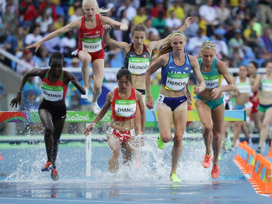 Courtney Frerichs leads a group across a barrier in the steeplechase on Saturday.