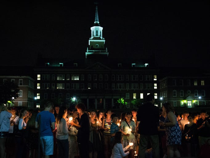 Following the kind words for Brogan Dulle and prayer, friends and family gathered by candle light outside McMicken Commons at the University of Cincinnati.