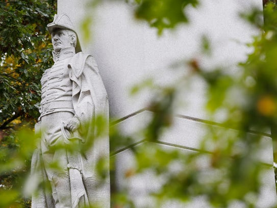 The statue of Gen. William Henry Harrison as seen through