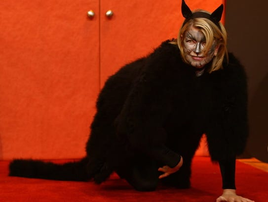 Martha Stewart really committed to her black cat costume