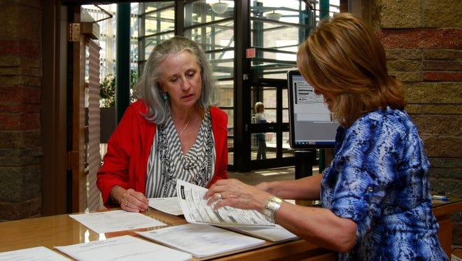 State Senate District 1 candidate Rebecca Morgan, left, is assisted by San Juan County Clerk Debbie Holmes with her paperwork, Tuesday at the San Juan County Clerk's Office in Aztec.
