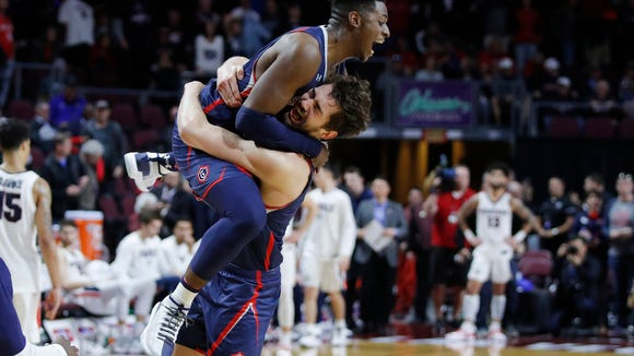St. Mary's Jordan Hunter, right, and Malik Fitts celebrate after their team defeated Gonzaga 60-47 in an NCAA college basketball game for the West Coast Conference men's tournament title, Tuesday, March 12, 2019, in Las Vegas. (AP Photo/John Locher)