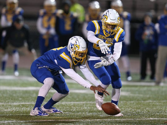 Irondequoit quarterback Freddy June Jr. can't handle the snap as he tries to hand off the ball to running back William Porter. Wilson beat Irondequoit 40-19 for the Class A title.