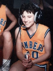 Rhonda (McKee) Reaves is interviewed after a game during her high school career.