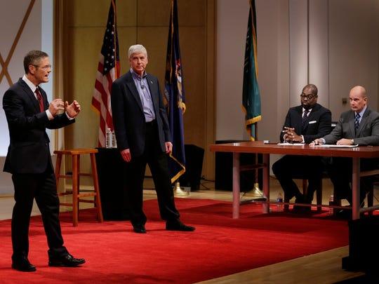 Republican Gov. Rick Snyder and Democratic challenger Mark Schauer talk during a town hall forum.