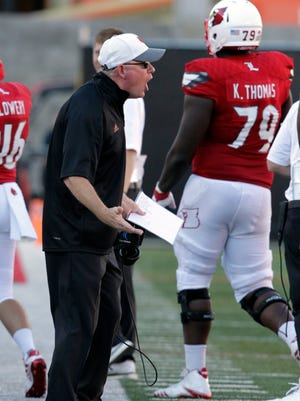 University of Louisville head coach Bobby Petrino reacts to the officials during the second half of play against Murray State University at Papa John's Cardinal Stadium in Louisville, Kentucky.      September  30, 2017