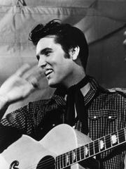 Elvis Presley is shown with his Gibson J-200 guitar