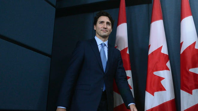 Prime Minister Justin Trudeau arrives to hold a press conference at the National Press Theatre in Ottawa, Ontario, on Tuesday, Nov. 29, 2016. Trudeau has approved one controversial pipeline from the Alberta oil sands to the Pacific Coast, but rejected another. On Tuesday, he approved Kinder Morgan's Trans Mountain pipeline to Burnaby, British Columbia, but rejected Enbridge's Northern Gateway pipeline to Kitimat, B.C.