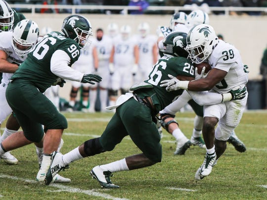 Michigan State RB Alante Thomas gets tackled by LB