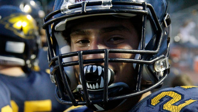 Naples LB Joe Napoli smiles against North Miami for the spring classic at Staver Field on Friday, May 20, 2016. (J. Scott Butherus/Staff)