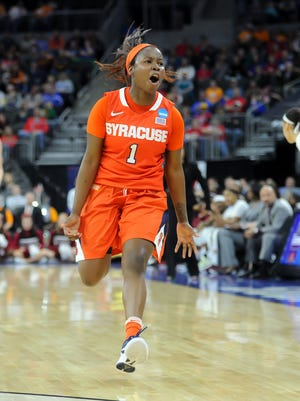Syracuse Orange guard Alexis Peterson (1) celebrates against the South Carolina Gamecocks in the second half of the semifinals of the Sioux Falls regional of the women's NCAA tournament at Denny Sanford PREMIER Center.