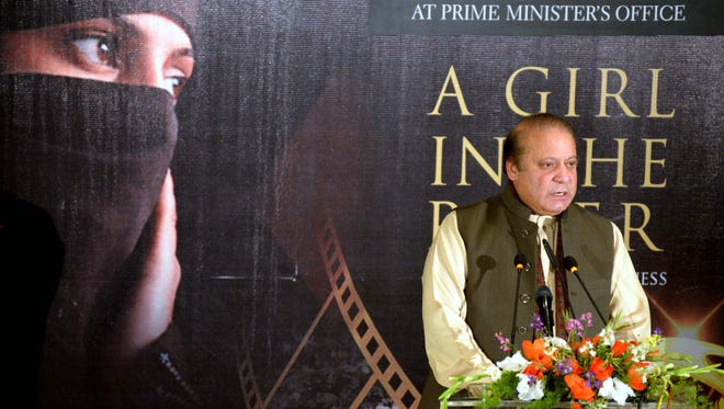 """Pakistani Prime Minister Nawaz Sharif speaks during a screening of """"A Girl in the River: the Price of Forgiveness' by Pakistani filmmaker Sharmeen Obaid-Chinoy at his office in Islamabad on Feb. 22, 2016. Sharif vowed Pakistan would eradicate """"evil"""" honor killings, the topic of the film."""
