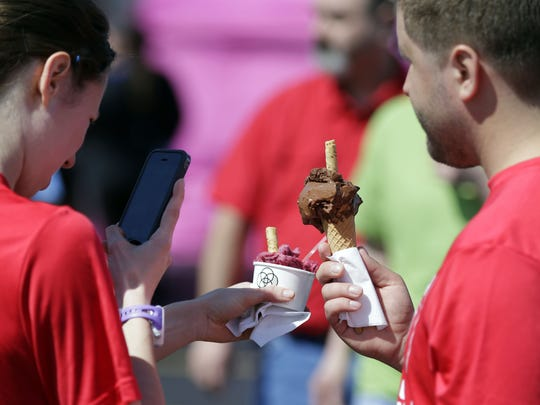 Kristin Stockheimer and Joseph Kenowski get a photo of their gelato as the Fox Valley Food Truck Rally and Generosity Kickoff earlier this month in Grand Chute. Fox Valley Food Truck Rally events are planned throughout the summer.