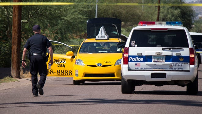 Police taped off 37th Street near Van Buren street in Phoenix on Saturday, Aug. 29, 2015, after a cab-fare argument led to a shooting, officials said.
