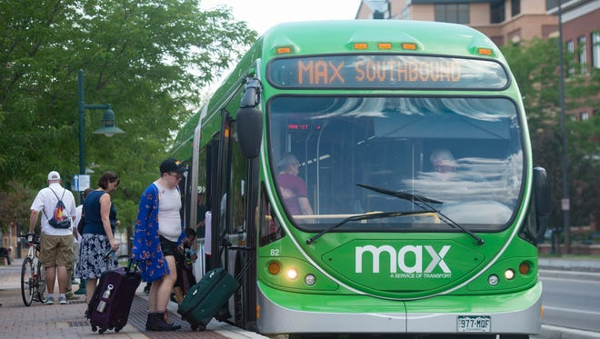 People board a MAX bus at the Fort Collins Downtown Transit Center on Thursday, June 14, 2018. Transfort announced that it will introduce mobile ticketing for the bus service running north and south on the Mason Street corridor.