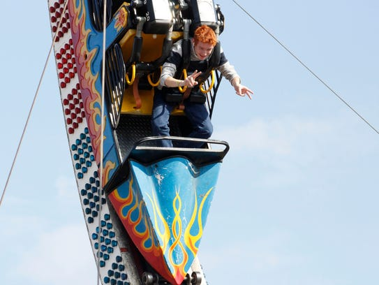 People enjoy the last weekend of the State Fair of