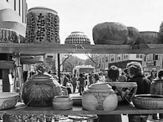 Pottery displayed for sale at the sidewalk art sale during East Lansing's Greenwich Village Days, 1973. The event would be renamed East Lansing Art Festival the following year.