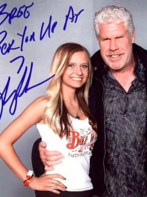 """Brianna Asher appears with Ron Perlman of the television series """"Sons of Anarchy."""""""