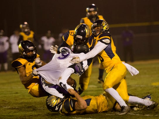 Northeast players go in to tackle Southwind's Trae