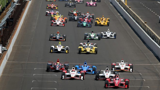 IndyCar drivers compete during the 99th running of the Indianapolis 500 Sunday, May 24, 2015, afternoon at the Indianapolis Motor Speedway.