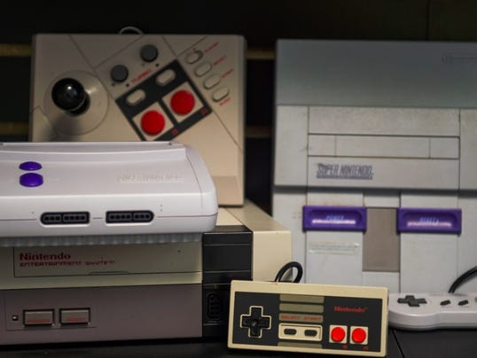A collection of Nintendo and Super Nintendo console systems for sale at Save Point in downtown Hanover. The retro video game store opened for business below Timeline Arcade on Carlisle Street.