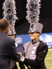 PCMB Drum Major Katie Wolf receives the award for semifinals at the Bands of America Grand National Championship.