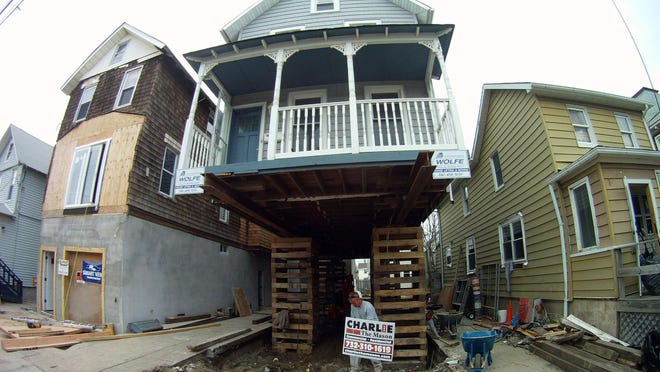 The house-lifting process under way in April 2013 on Center Street in Sea Bright.