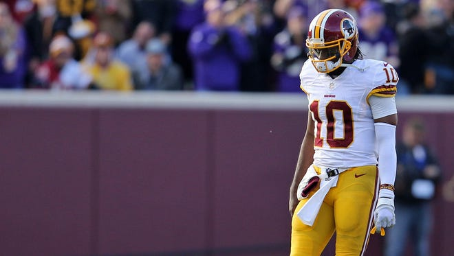 Washington Redskins quarterback Robert Griffin (10) reacts after a play during the fourth quarter against the Minnesota Vikings at TCF Bank Stadium.