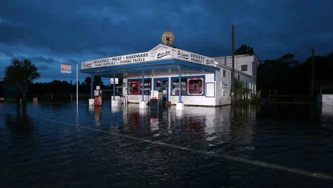 Bo Lynn's Grocery store rests partially underwater in St. Marks, Fla. Friday morning in the hours after Hurricane Hermine passed through on Sept. 2, 2016. Waters overnight rose to a few feet within the store. (1)