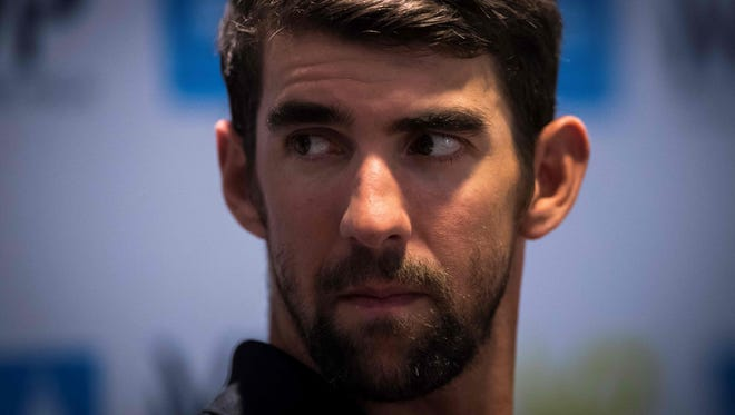 Michael Phelps looks on during a press conference at the Molitor swimming pool on Feb. 16.