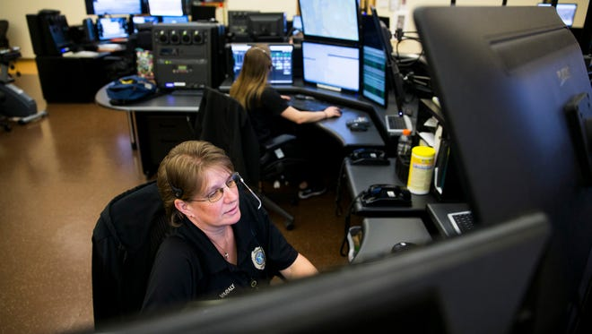 Shaunna Varaly checks her computer screens while working as a dispatcher at the Collier County Emergency Management building on Tuesday, April 18, 2017. Dispatcher job duties include answering 911 telephones, providing lifesaving medical instructions, transmitting vital information to emergency personnel via the radio, relaying information via the Computer-Aided Dispatch terminal and answering administrative lines.