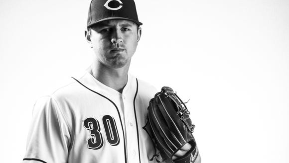 Cincinnati Reds starting pitcher Tyler Mahle (30) poses