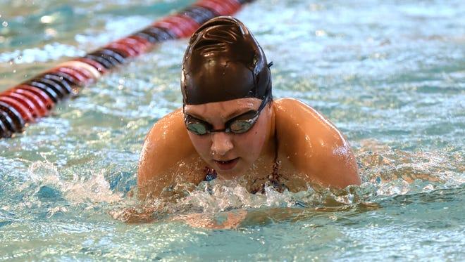 Watkins Memorial senior Kelsey Seas practices at Denison University earlier this season.