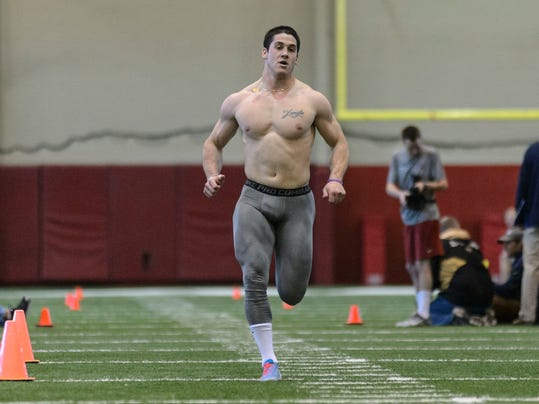 Vinnie Sunseri does the 40-yard dash during Alabama football's second 2014 pro day, Tuesday, April 8, 2014, at the Hank Crisp Indoor Facility in Tuscaloosa, Ala.  (AP Photo/Alabama Media Group, Vasha Hunt) MAGS OUT