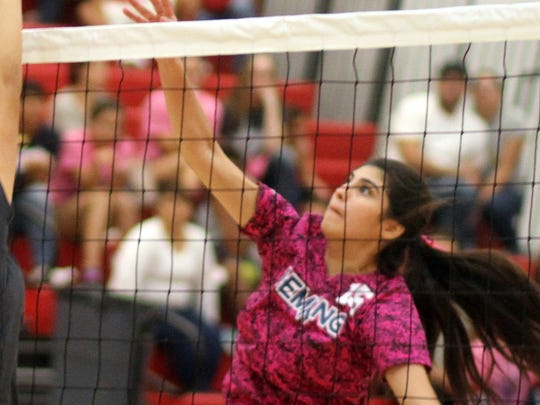 Lady Cat outside hitter Jolene Perez (15) attempted to guide this shot past the tandem block from the Chaparral Lobos.