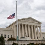 A flag in the U.S. Supreme Court building's front plaza flies at half-staff in honor of Justice Antonin Scalia on Feb. 25 in Washington, D.C.