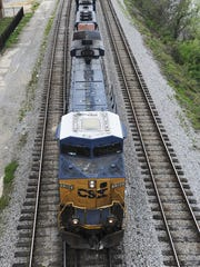A freight train runs along the Alabama River in downtown Montgomery, Ala. on Wednesday March 21, 2012. (Montgomery Advertiser, Mickey Welsh)