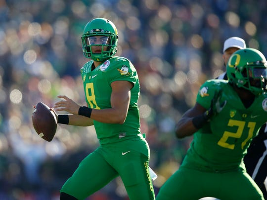 Oregon quarterback Marcus Mariota was fun to watch at Oregon. He zipped the ball, darted through defenders when he took off running. But Whisenhunt doesn't want a quarterback who can run.