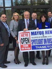 From left: John Crisafulli, AVP/Small Business Banker, April Huchko, VP/Assistant Director, Retail Banking South for Kearny Bank, Mayor Owen Henry, Valentin Kazanovich, VP/Commercial Loan Officer, Mona Cach, AVP/Branch Manager Old Bridge Kearny Bank Office and Steve Mamakas, Executive  Director of the  Mayor's Office of Economic Development and Chairperson of the Old Bridge Business Alliance at a recent networking  event spotlighting Kearny Bank.