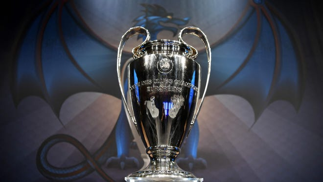 The UEFA Champions League trophy is displayed before the round of 16 draw.