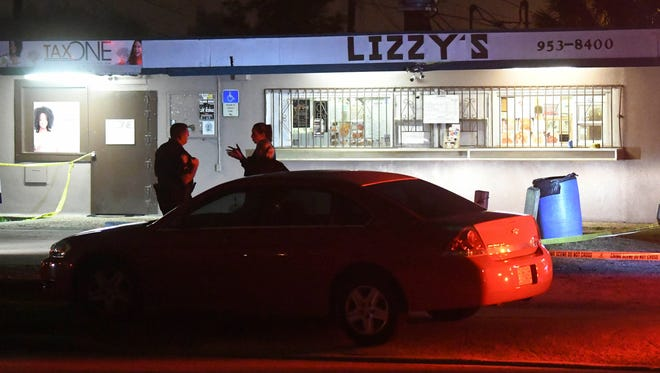 Melbourne police investigate the scene of a shooting Tuesday evening at Lizzy's Restaurant on University Blvd.  Police say no one was injured in the incident although one person was transported to the hospital due to either broken glass or shrapnel.