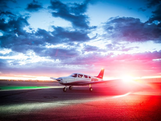 636638997462595557-plane-and-sun.jpg
