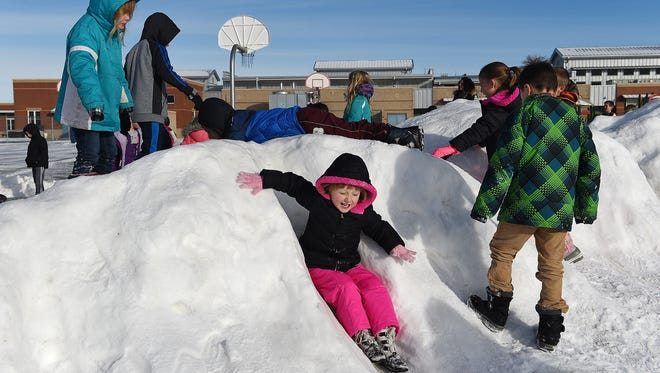Iszabella Aman slides down a snow pile during recess at Rice Elementary in Wellington on Thursday, January 12, 2016. Enrollment in Poudre School District grew by 62 students this year, far fewer than the projected 392.