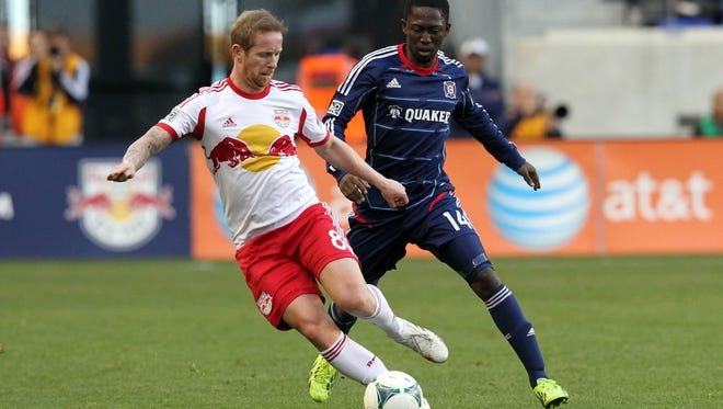 New York Red Bulls defender/midfielder David Carney and Chicago Fire forward Patrick Nyarko fight for the ball during the first half at Red Bull Arena.